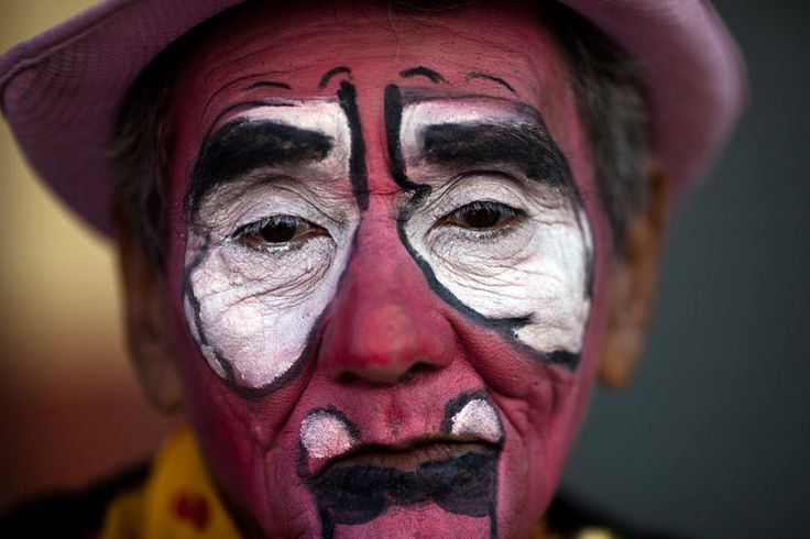 Cacharrito, 74, poses for a picture during the 3rd Latin American Clown Congress parade in Guatemala City  Photograph: Rodrigo Abd/ AP