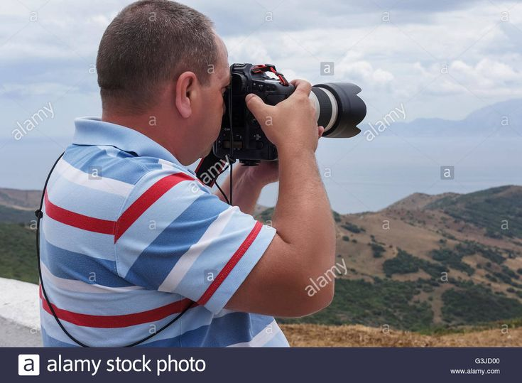 Download this stock image: photographer at the Strait of Gibraltar, Spain - G3JD00 from Alamy's library of millions of high resolution stock photos, illustrations and vectors.