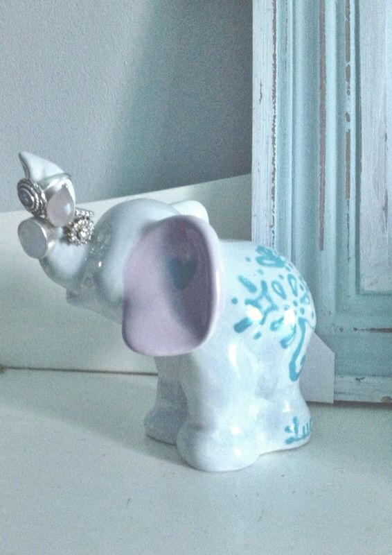 Hand painted elephant ornament used as a ring holder