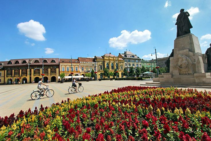 Churches, cafes, fountains, and shops make pretty Kossuth Square the center of life in Debrecen, Hungary