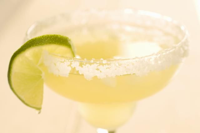 Cocktail recipe for a Golden Margarita, an orange-flavored variation of the classic Margarita that specifically uses gold tequila along with orange liqueur, lime juice and an optional addition of orange juice or Grand Marnier.