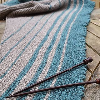Indulge your love of garter stitch and colourful stripes in this fun, simple to knit shawl.