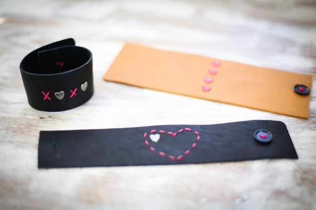 Make a stylish DIY Leather Bracelet with the buttoned cuff tutorial. Perfect for Valentine's Day with heart stitching and heart brads.