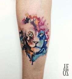 Watercolor lion forearm piece by Yeliz Ozcan.  http://tattooideas247.com/watercolor-lion/