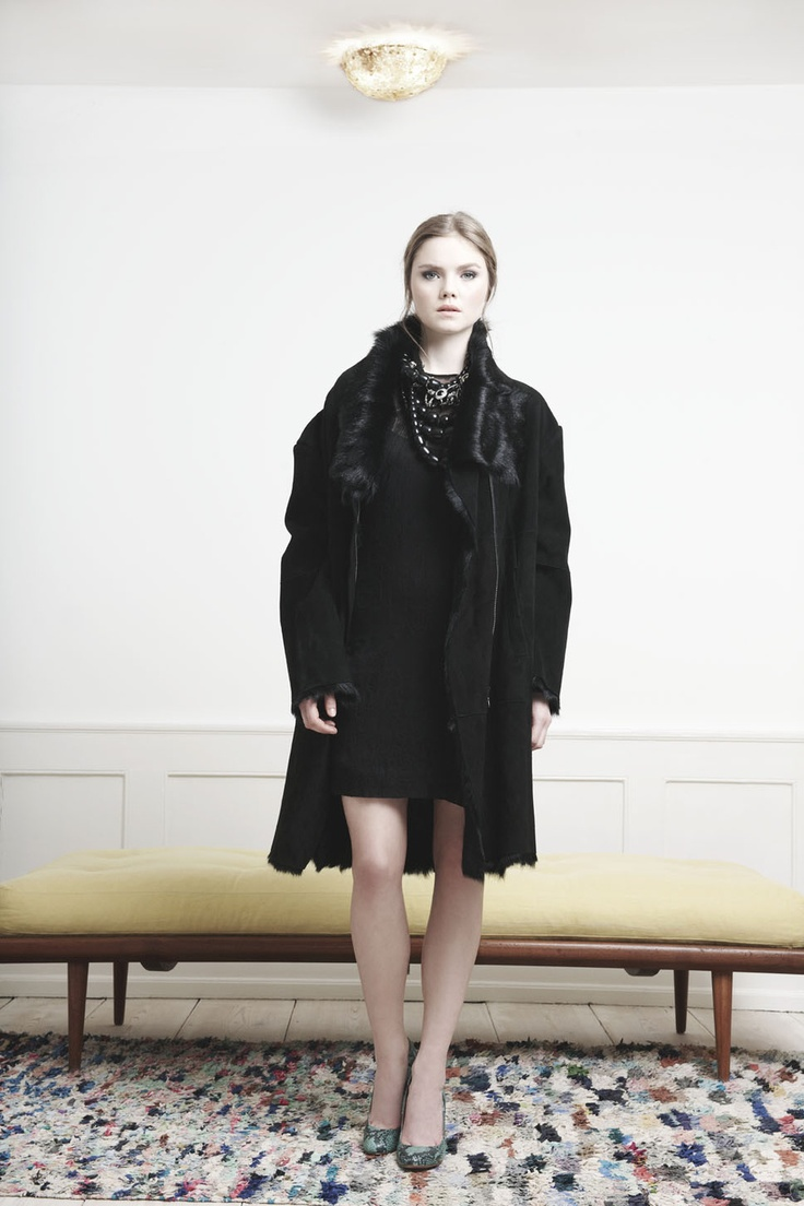 Rützou long black Capra fur coat and black sheer stitch dress