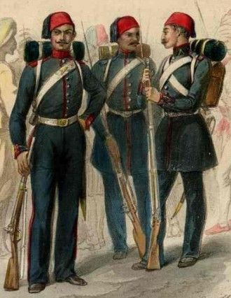 Three Crimean War Turkish Soldiers, from a period illustration representing: Foot Artillery, and note in particular the cross-cannon badge on the cross-belt, as well as the buckle. The red collar, cuffs and shoulder boards, worn on an 1840s wool shell jacket. Infantry soldier, with long blue frock coat. Infantry junior officer, whose rank-band is identified by the red tape chevron on the collar.