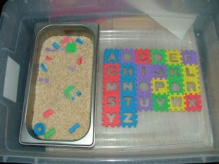 For this activity I had this foam alphabet puzzle that I got for 88 cents at Walmart:) and a dish of rice. I popped out all the letters and mixed them in with the rice. I set this up in the sensory tub so Caden already new the rules and everything would stay neat. Here is a picture of how I set this activity up.
