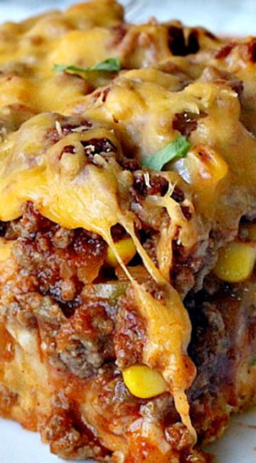 Cheesy Taco Bake ~~~  This amazing entree has a Bisquick and cilantro crust, a beef, corn and salsa layer then topped with cheddar cheese. Easy and delicious.