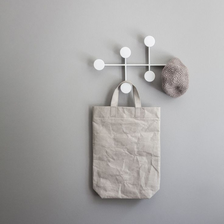 Storage racks and towel bars don't need to be boring. We love this set of Scandinavian-style wall hooks from Menu.