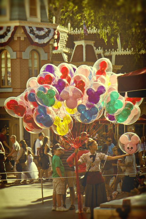 Girl with Balloons on Main Street in Disneyland