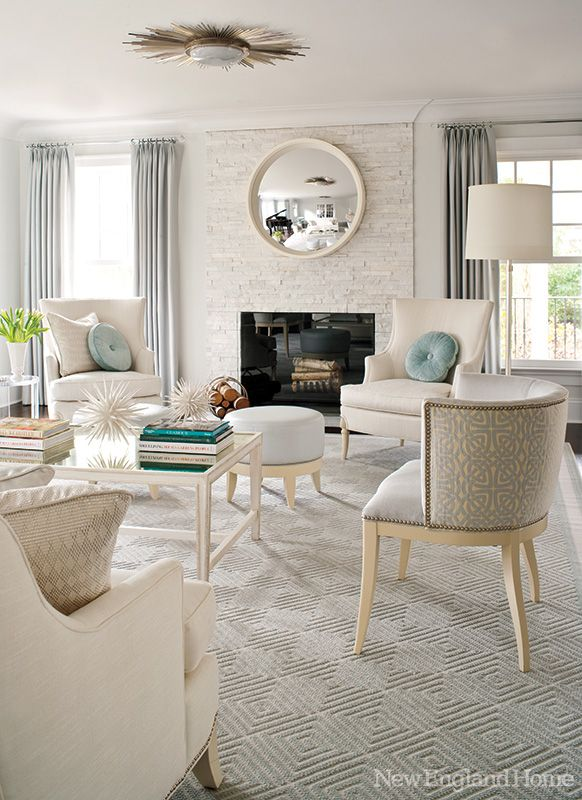 A modern and glamorous Greenwich home tour! From Mix and Chic. White + Aqua living room.