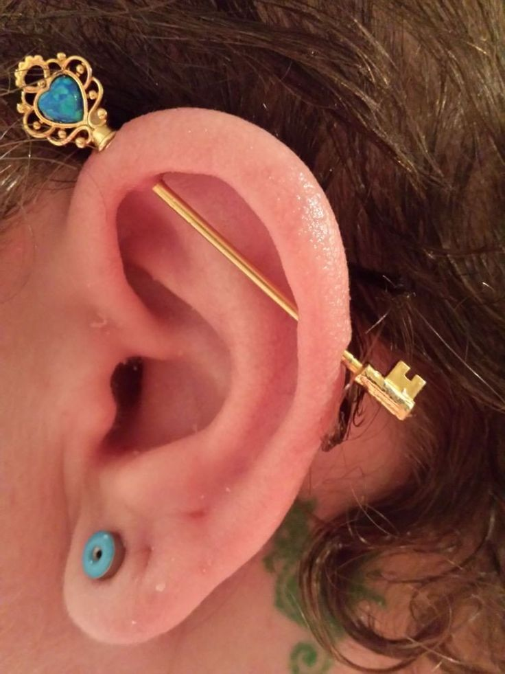 Opal Key Industrial Barbell Piercing in 14G Gold at MyBodiArt