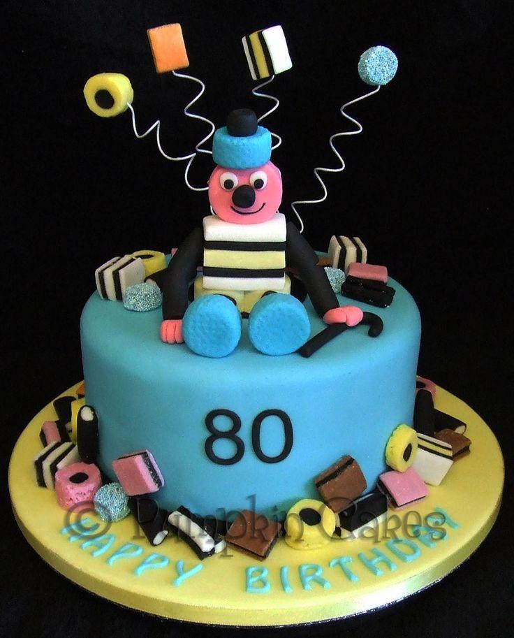 Fun Bertie Bassett cake for a liquorice allsort lover. All edible decoration