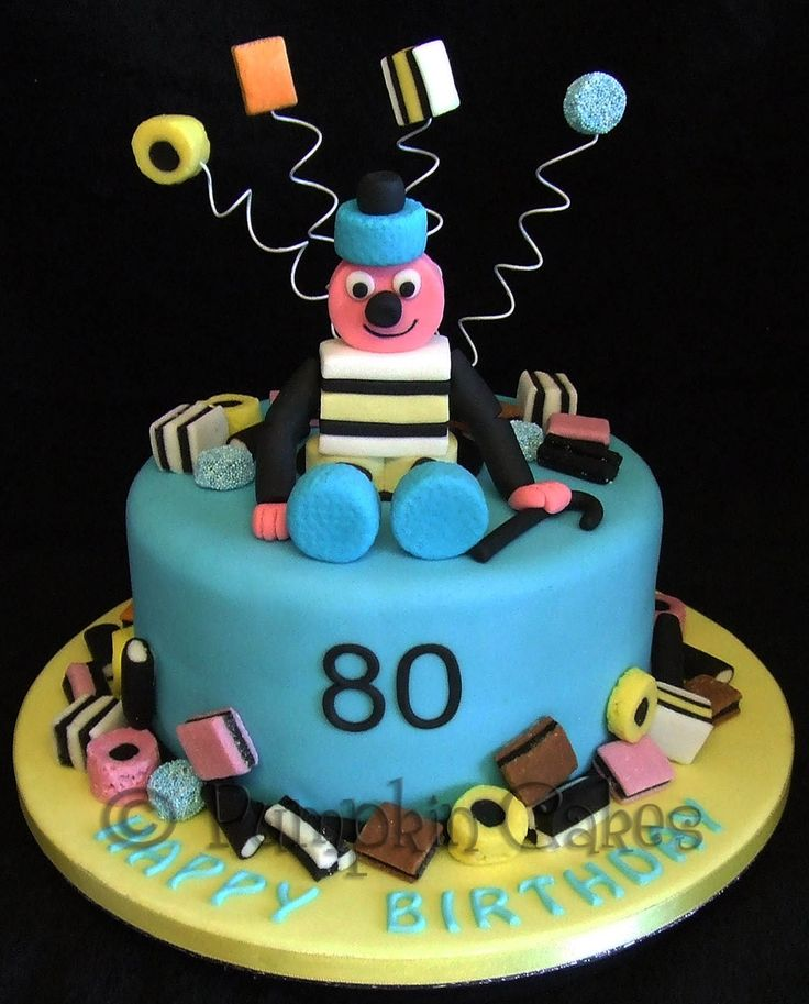 Fun Bertie Bassett cake for a liquorice allsort lover.  All edible decoration