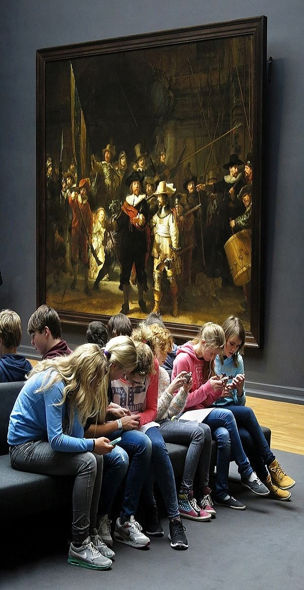 An image of schoolchildren seemingly distracted on mobile phones in front of   Rembrandt's 'The Night Watch' masterpiece is again being shared online