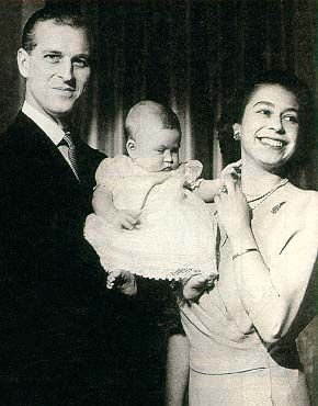 Queen Elizabeth II with Philip and baby Charles. I love how natural her grin is. Charles looks appropriately dour.