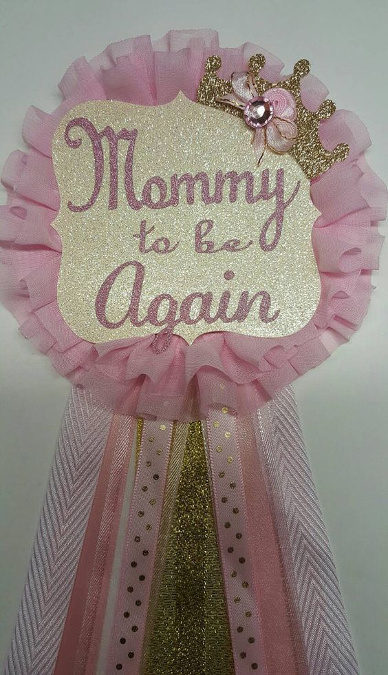 Elegant mommy to be corsage for your pink and gold princess royal baby shower theme. Shimmery gold tiara a shimmery mommy to be tag on a #BabyShower