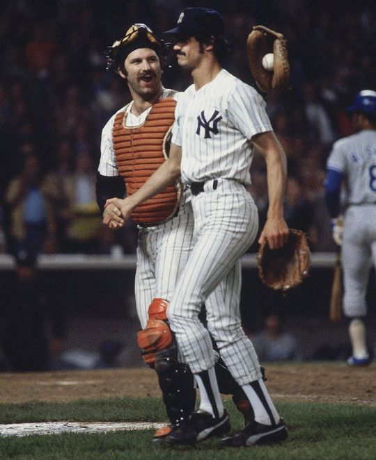 """Thurman Munson congratulates Ron Guidry on his complete game victory in the Yankees 5-1 win over the Dodgers in Game 3 of the World Series on Oct. 13, 1978 at Yankee Stadium. Guidry, a four-time All-Star and 1978 AL Cy Young award winner, nicknamed """"Louisiana Lightning"""" and """"Gator,"""""""
