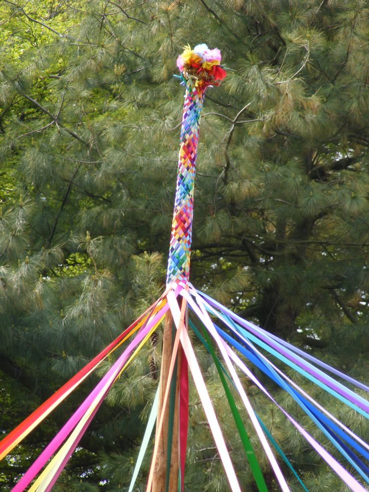 maypole-top. Maypoles and Morris dancing for Beltaine.