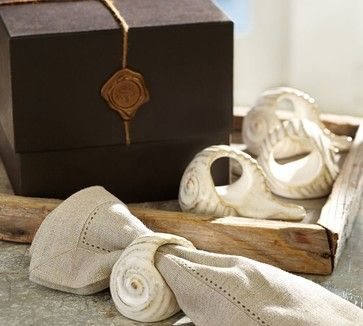 Ceramic shell napkin rings from Pottery Barn bring a beach vibe to your summer table. Set of 4. - $39.50