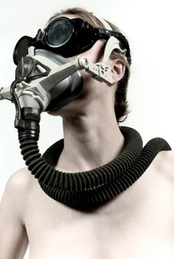 Cyborg feminism - woman with face mask and goggles