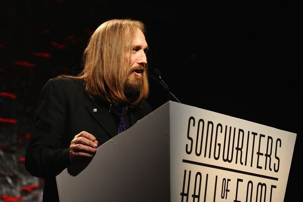 Tom Petty Photos Photos - Tom Petty speaks onstage during the Songwriters Hall Of Fame 47th Annual Induction And Awards at Marriott Marquis Hotel on June 9, 2016 in New York City. - Songwriters Hall Of Fame 47th Annual Induction And Awards - Show