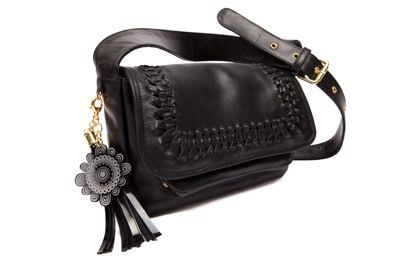 """""""Florens"""" hip bag is the perfect style to take you from day-to-night and is beautifully hand crafted in noir shiny cow leather.External features:Woven lacing leather detail on flap of the bag and magnetic closureAdjustable long leather strapGold hardwareFront pocket with small gold stud detail on sideJacinta Lepoutre detachable acrylic flower key chainInternal features: Jacinta Lepoutre bordeaux signature lining Zip pocket with noir leather trim..."""