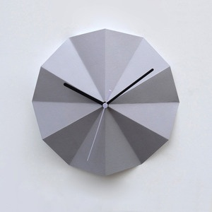 Grey radial clock by Richard Shed made from folded 250gsm card. There's another more playful version, inspired by the old fashioned colour wheels.