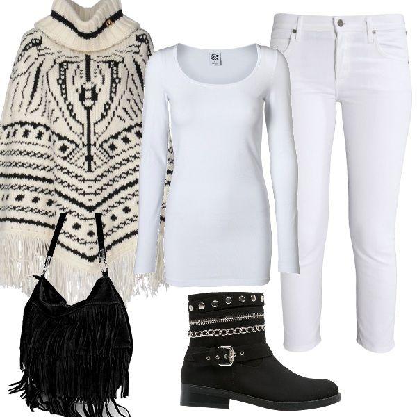 La mantella dalla fantasia etnica è la protagonista di questa composizione; viene proposta con un paio di jeans bianchi e una maglietta basic a manica lunga, stivaletti neri con decori in metallo e una borsa a tracolla con frange.
