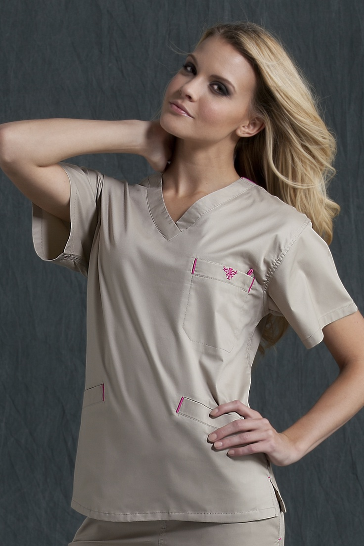 "8403 Signature Top - Peaches Uniforms from Scrub Couture  V-neck top  Chest velcro pocket with badge holder  Front angled welt pockets  With invisible inside pockets  Length: 26""  XS - 3XL  $24.00"