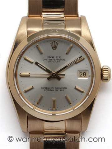 Rolex 18K YG Oyster Perpetual Midsize Datejust ref #6827 31mm diameter case with smooth bezel serial # 6.4 million circa 1980 with original silver satin dial with gold applied indexes and matching gold hands. Self winding non quick set chronometer rated movement with sweep seconds and date. With Rolex signed 18K YG riveted link Oyster bracelet. A beauty for a dress up or sporty look. Shown with a non cyclops crystal for a cleaner look.