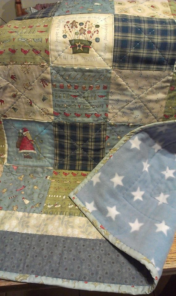 The back of this Anni Downs fabric Christmas baby quilt was a lovely fleece fabric