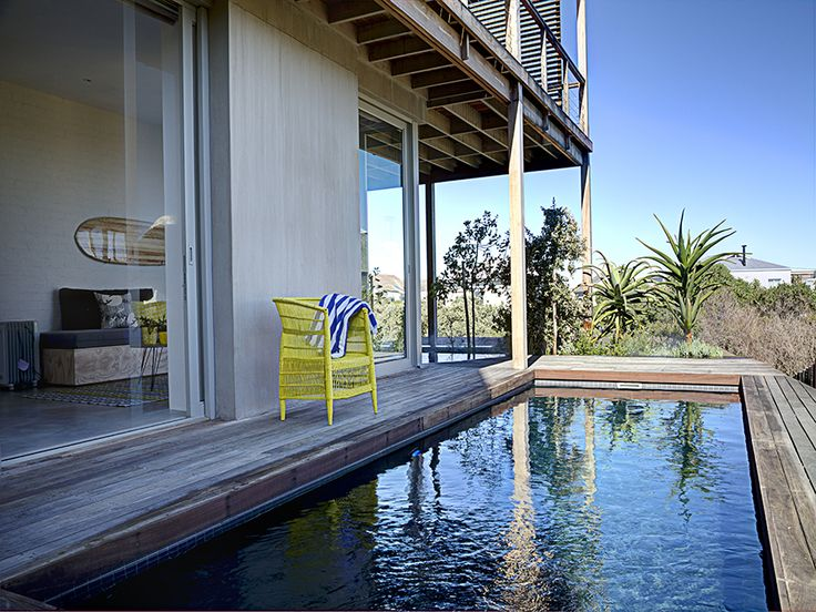 Large sliding doors give access to the pool deck with its unobstructed views. Can you begin to imagine the unreal sunsets?