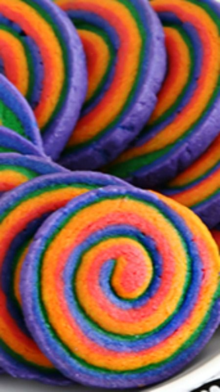 Rainbow Spiral Cookies ~ These cookies are absolutely eye-popping and a little psychedelic-looking, too!. They have the benefit of slice-and-bake convenience, so make a few batches to store in the freezer... They are buttery beyond words, so use the best quality butter you can find