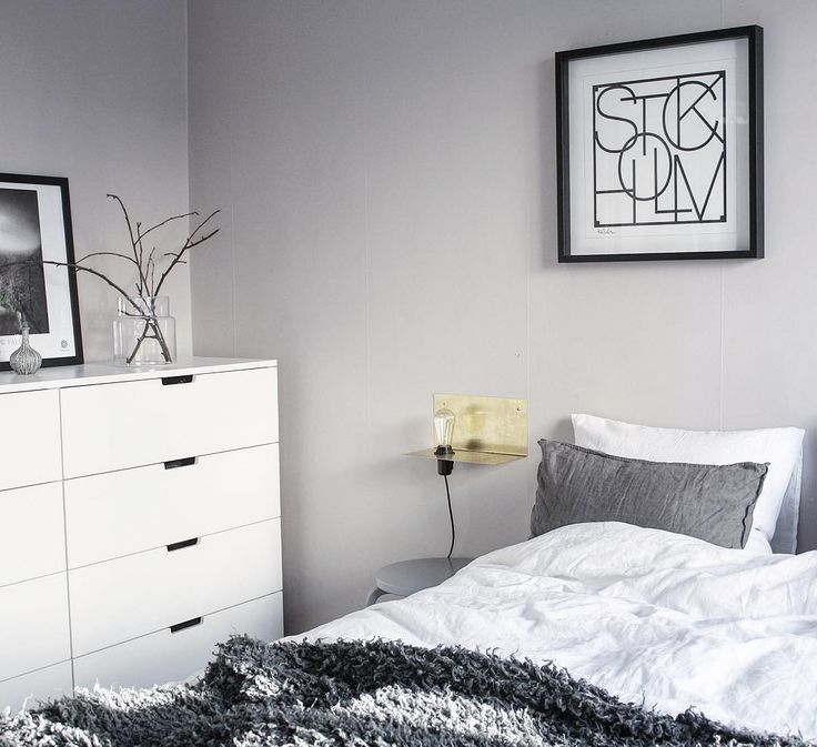 Ikea 'Nordli' dresser in grey & white bedroom with golden accent @linneasinterior