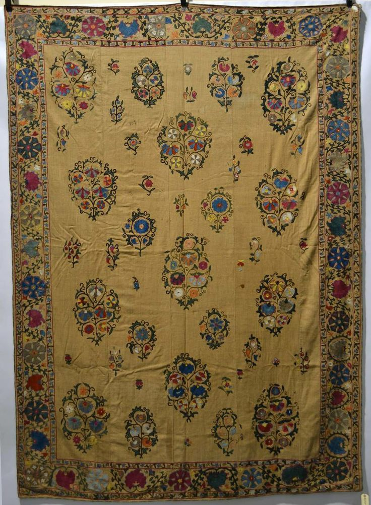 Attractive Nurata suzani, silk embroidered with typical floral sprays within a floral and medallion border worked mostly in basma stitch on a beige cotton ground, Uzbekistan, late 19th century, 96in. x 68in. 244cm. x 173cm.