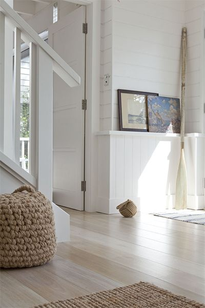 Timber floors throughout are all part of the look, either in a very dark chocolate brown or pale and bleached. Add natural rugs such as sisal or jute