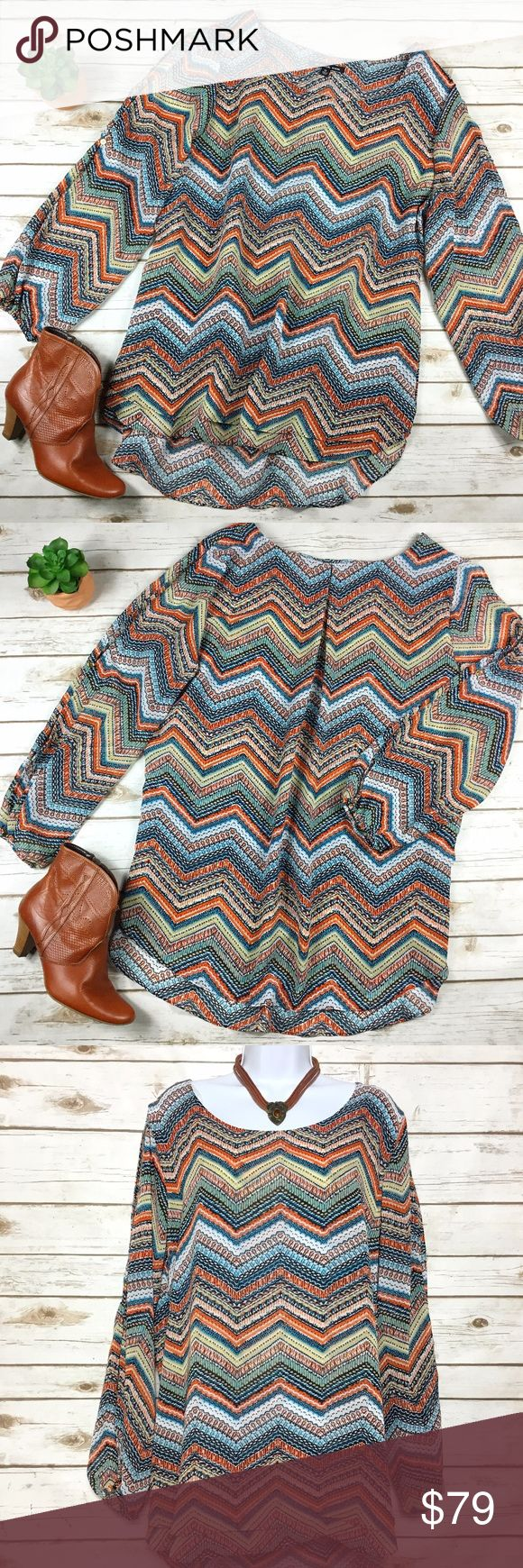 Zac & Rachel Plus Size Chevron Print Layered Tunic Plus size layered abstract chevron print top or tunic by Zac & Rachel has long split sleeves with gold button closure at the cuffs. Great colors make this a super versatile piece! 100% polyester. Size 2X, measures about 24 inches across from armpit to armpit, and 29 inches in length in front and up to 33 inches in back. B5 Zac & Rachel Tops Tunics