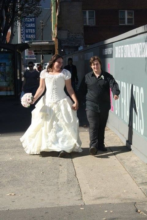 Nicole Ross wearing a GS bridal ensemble in ivory bouquet striding through the city. #bridal #corset #galleryserpentine