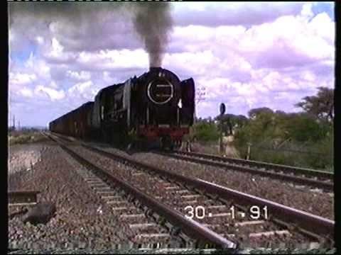 South African Railways class 25NC 3488 working up Modder River bank 1991
