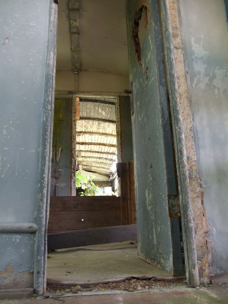 View through old carriages from 30´s (cemetery of old carriages near Čerčany)