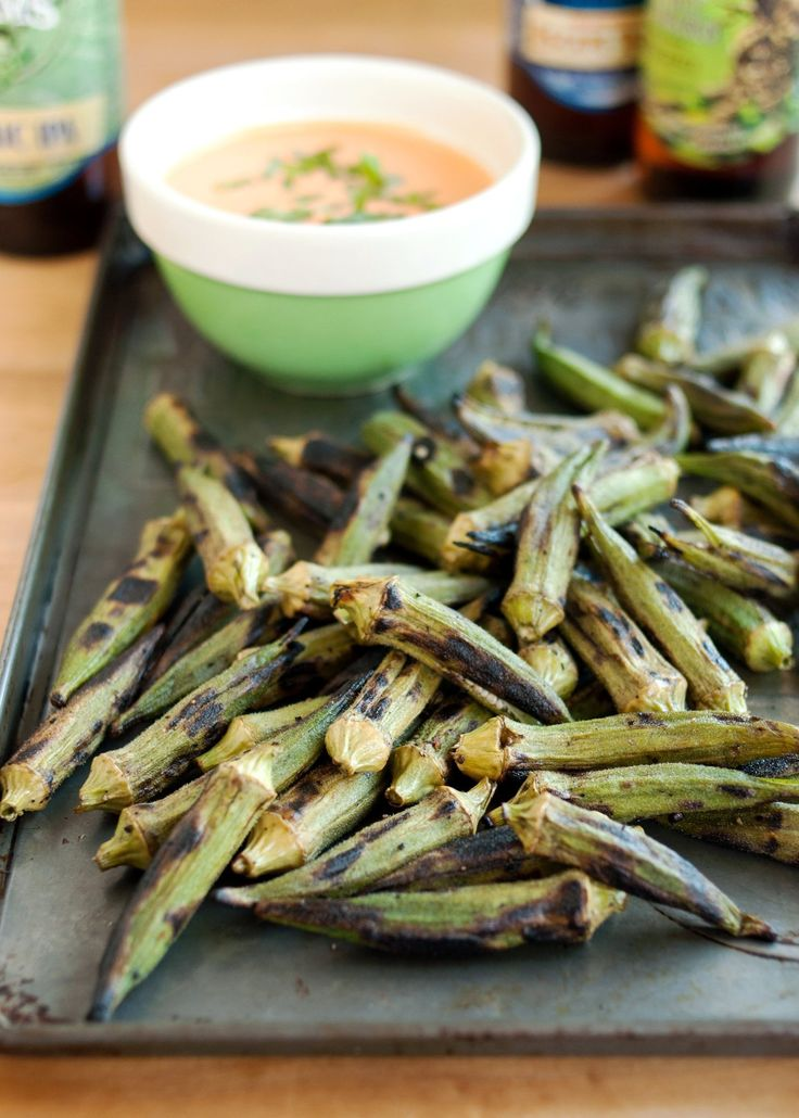 This recipe is about trust. Because I know okra can be a tough sell. I get it. And I'm not going to tell you that these grilled okra spears taste like French fries or anything else — they taste like okra. Which I happen to love.      I love their earthy and undeniably green flavor. I love the charred bits that get crispy on the grill (which are, admittedly, rather fry-like). I love the way the seeds pop between my teeth. This is the recipe that made fall in love with okra. Trust me on this…