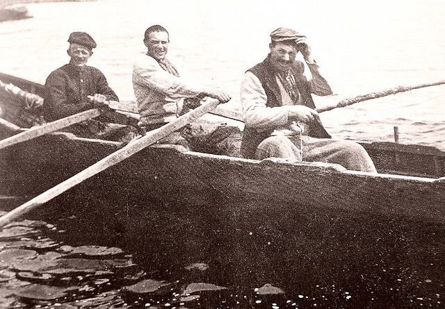 Inis Meáin by Fergal of Claddagh, via Flickr. Three islanders in a Curragh. These boats ride high and fast on the water and were also used to trade salted bream for turf with Connemara. The islanders would row 14 miles into the mainland with a cargo of potatos and salted fish and return with turf. There was no natural source of fuel on the island