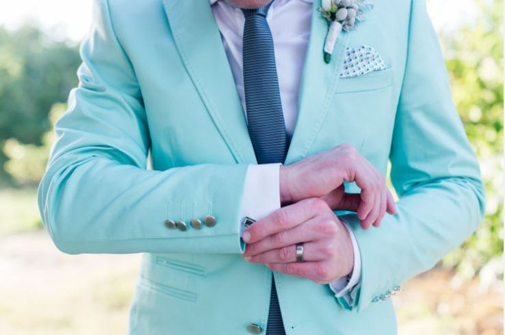 Fun and different groom outfit. Mint jacket with charcoal tie, white shirt and charcoal skinny pants. Very effective for the groom wanting something different.  ~ Image Property of Darren Bester Photography