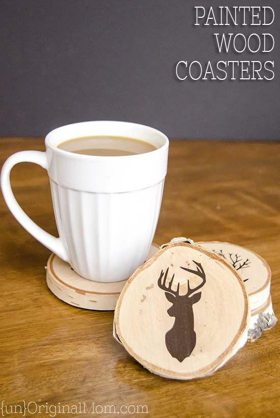 DIY Painted Wood Slice Coasters - cut a vinyl stencil or buy a pre-made one from the craft store for these easy and personal handmade gifts.  This would be a great gift for guys!