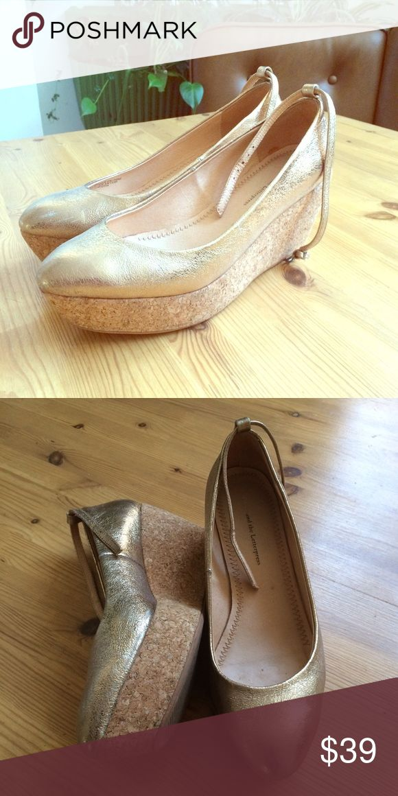 """Gold Anthropologie Pico Flatforms Ideal for the gal who wants height without the sore tootsies, flatforms complement almost everything, from frothy party frocks to cropped skinnies. Pilcro's pair comes in a variety of hues and fabrications, which means just one thing: get thee one in every color. // By Pilcro  Fits true to size  Adjustable / removable buckle  Leather upper   Leather insole  Rubber sole  3"""" cork wedge; 1.25"""" platform  Style No. 26835850 Anthropologie Shoes Platforms"""