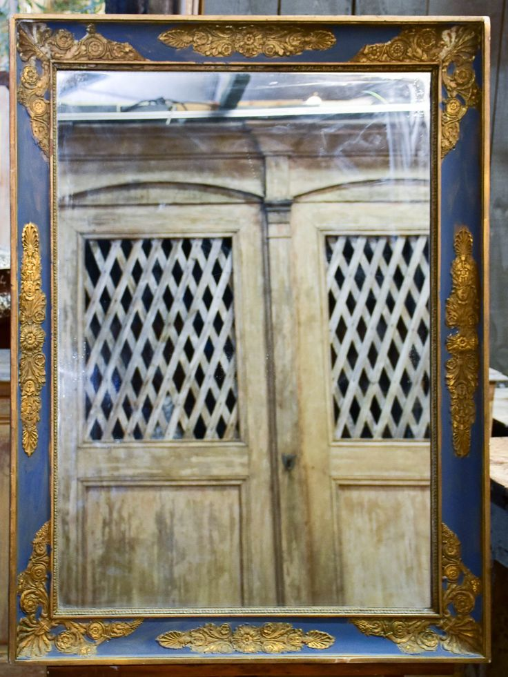Large antique restoration mirror with blue and gold frame