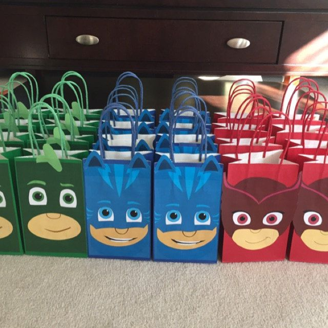 Tina Napier added a photo of their purchase. These are our customer's assembled PJ Masks Party Goody Bags she made with the Printable templates she bought from our Etsy Shop!! PJ Masks Birthday Party Ideas/ PJ Masks Party Favor Bags/ PJ Masks Party decorations/ treat bags/ candy bags/ gift bags/ goodie bags.