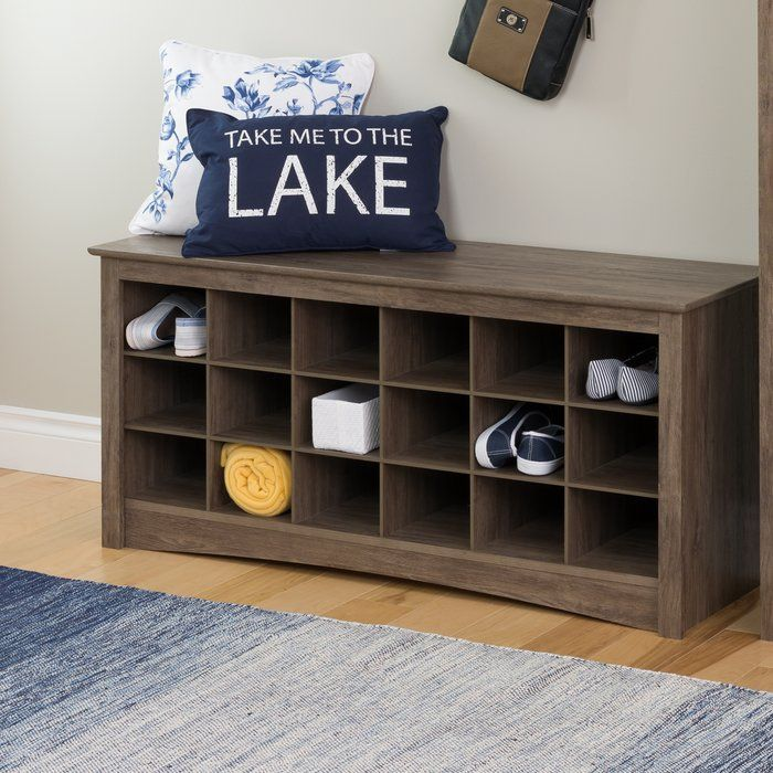 Store your shoes where you put them on with Prepac Shoe Cubby Rack. Dual-purposed and versatile, this bench is a great addition to your foyer, mudroom, utility room or bedroom. Each of the 18 individual cubbies is spacious enough to hold a pair of size 13 men's shoes, keeping them neatly stored and out of the way. It's the perfect piece to keep your shoes organized.