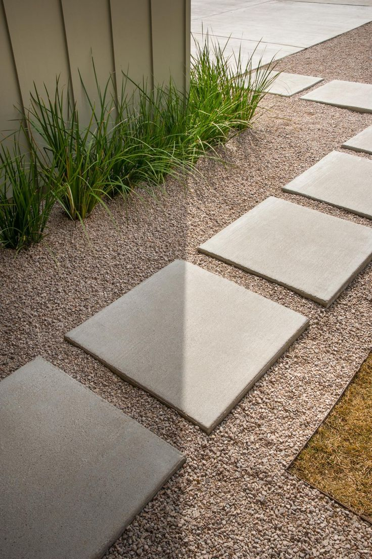 Concrete pavers in a gravel path lead the way to the front door. Drought-tolerant grasses line the landscape and are easy to maintain. It's black-thumbs approved! --> http://www.hgtv.com/design/hgtv-smart-home/2015/front-yard-pictures-from-hgtv-smart-home-2015-pictures?soc=smartpin